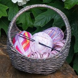 knitting needles in basket